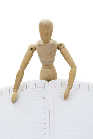Planing agenda with wooden mannequin isolated in white background  photo