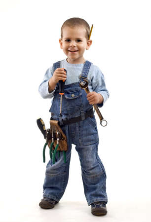 Little boy plays construction worker. Isolated on white