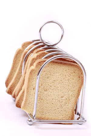 Breakfeast toast placed on holder isolated in white