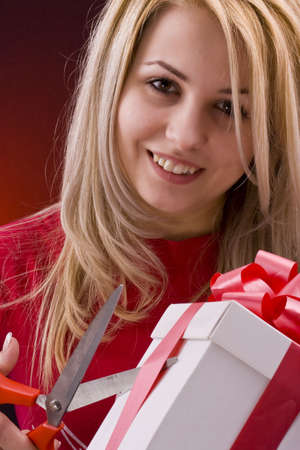 Girl holding a gift and smiling photo