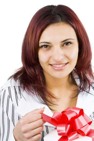 Girl holding a gift and smiling, isolated on white background photo