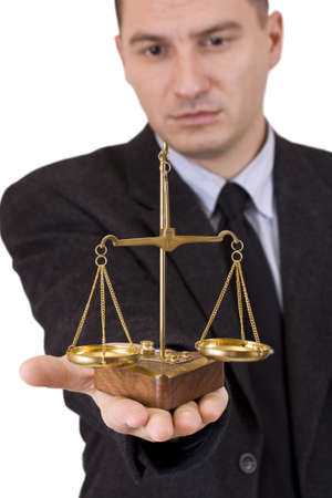 impartial: A business man holding a justice scale, isolated in white background