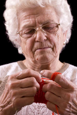arthritic: Macro of grandmothers hands knitting