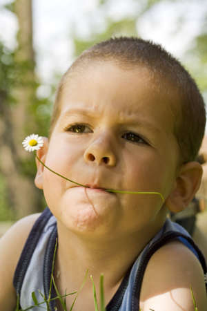happy boy having fun outdoors , whit flower Stock Photo - 7188664