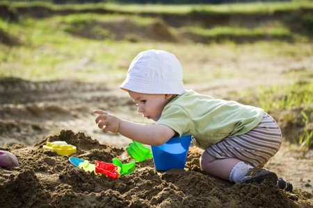 Little child play with sand Stock Photo - 7188668