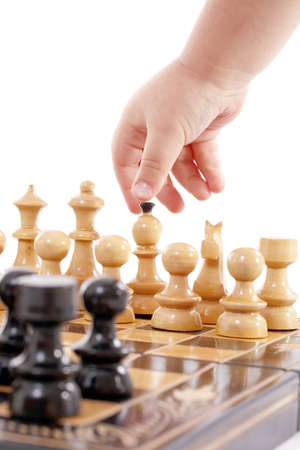 Childre hand with chess, isolated in white Stock Photo - 7259579