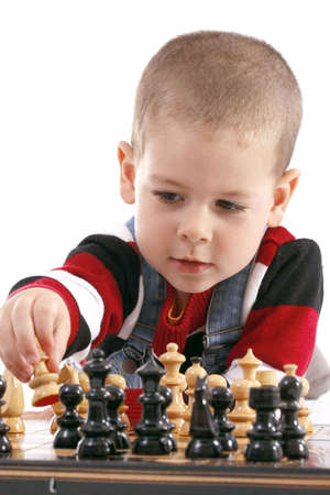 Childre playing with chess in white background, studio shot