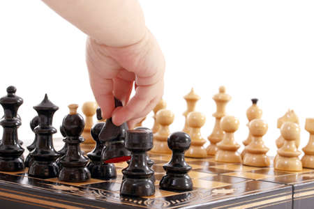 battle plan: Childre hand with chess, isolated in white Stock Photo