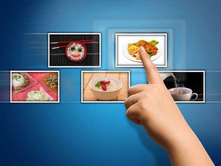show hands: hand selecting images streaming from the front Stock Photo