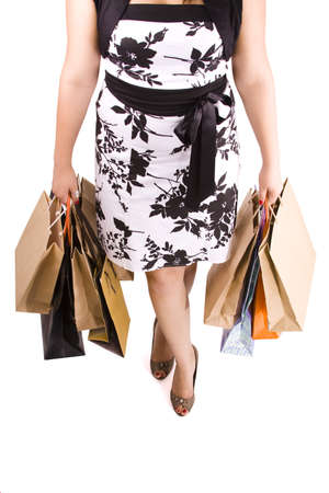 Waist-down view of young woman carrying shopping bags Stock Photo - 7697942