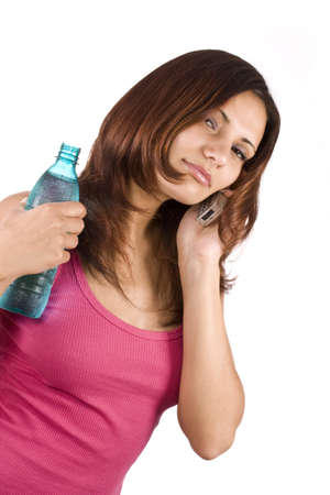 celphone: beautiful woman with bottle of water and cellphone over white