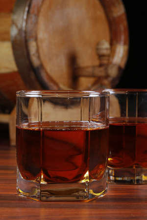 temperance: glasses from old whisky on a wooden table