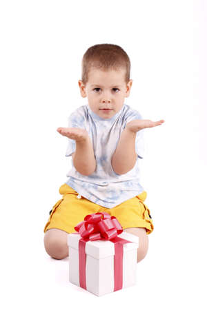 Little boy whit a gift box isolated on white  photo