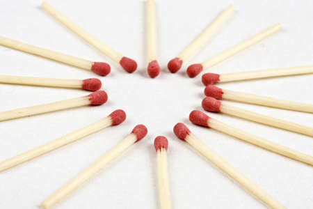 Macro closeup a group of matches in heart form photo