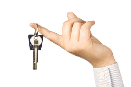 Woman holding a key for a house on a keychain  Stock Photo - 7999811
