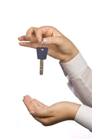 Woman holding a key for a house on a keychain  Stock Photo - 7997518