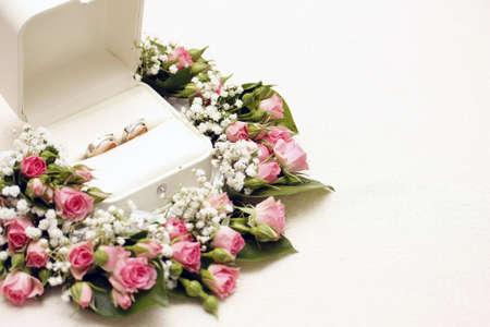 engagements: wedding rings and roses arangements Stock Photo