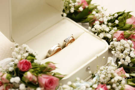 wedding rings and roses arangements Stock Photo