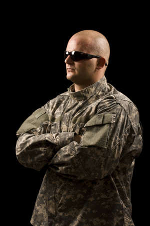 young man wearing military suit in sun glasses Stock Photo - 8091507