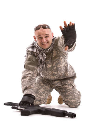 soldier with hands up, isolated in white photo