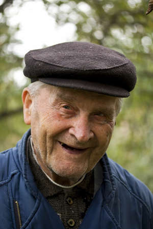 Portrait of an Old Man Smiling To Camera