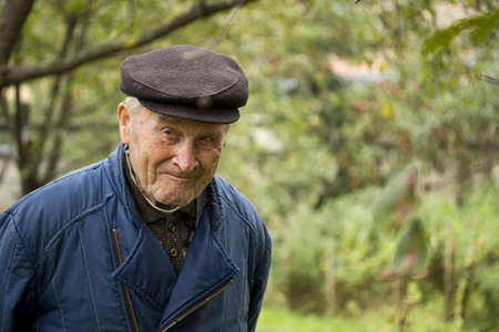 Portrait of an Old walking in garden Stock Photo - 8091571