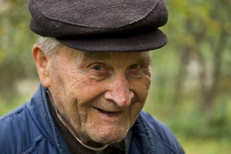 Portrait of an Old Man Smiling To Camera  photo