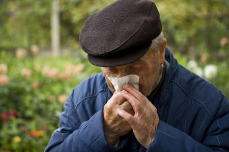 old man blowing his nose Stock Photo - 8091574