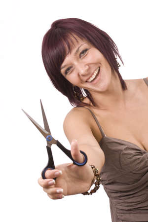 hairstyling: Female cutting  herself  isolated in white Stock Photo