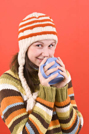 smiling woman with cup of hot-something photo