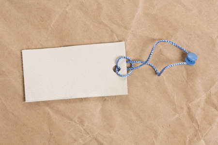 blank tag label, in background old crumpled paper Stock Photo - 8306628
