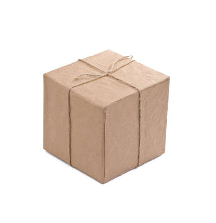 Cardboard carton wrapped with brown paper and tied with string  photo