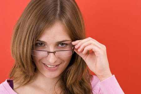 woman wearing glasses: Happy Woman in red background