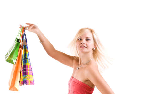 Portrait of an attractive young female holding shopping bags against white background  photo