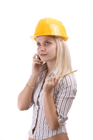 Young architect-woman wearing a protective helmet standing Stock Photo - 8387368