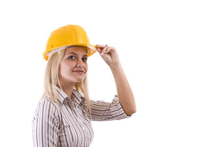 Young architect-woman wearing a protective helmet standing Stock Photo - 8387146