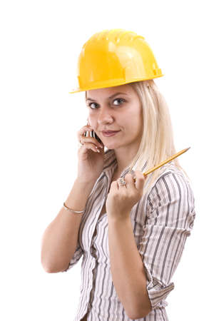 Young architect-woman wearing a protective helmet standing Stock Photo - 8387271