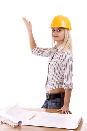 Young architect-woman wearing a protective helmet standing Stock Photo - 8387187