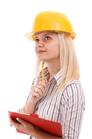 Young architect-woman wearing a protective helmet standing Stock Photo - 8387405