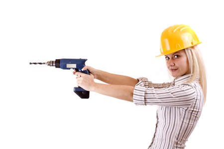 Young woman with drill machine, isolated on white background photo