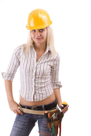 Sexy construction worker with tool bag and a lot of equipment suspenders a jeans photo
