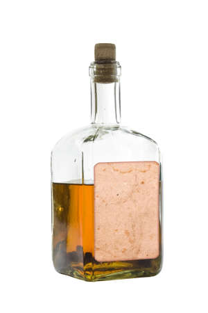 Antique bottle of spirits, isolated over a white background photo