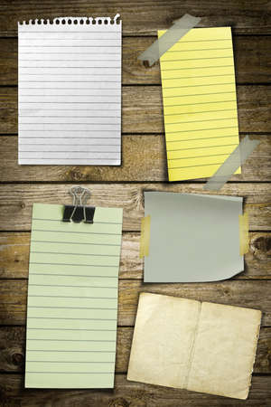 Collection of various note papers on wooden background Stock Photo - 8592447