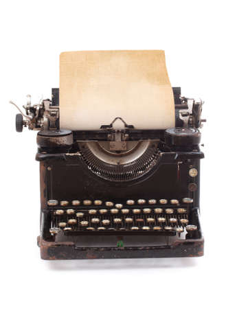 Old vintage typewriter with a blank sheet of paper inserted  photo