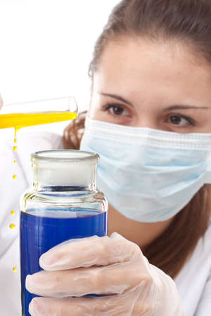 Young scientist woman make accident, pouring chemicals  in a laboratory  photo