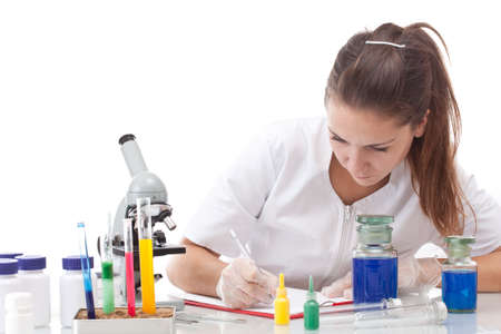 Serious female scientist writing on her clipboard Stock Photo - 8690067