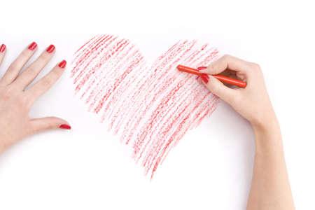 corazon dibujo: Mano con l�pices de cera coraz�n de dibujo