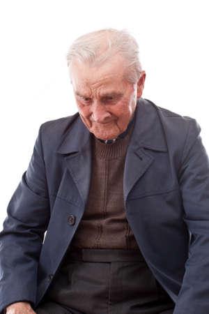 minded: Minded senior man over white background