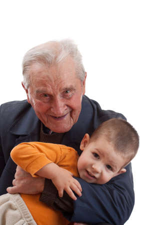 Studio portrait of grandfather playing whit grandson  photo