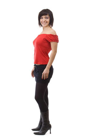 Young woman posing in short skirt. Isolated over white background  photo